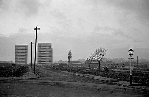 Tower blocks advance across a slum cleared site , Hockley Birmingham  (1967)