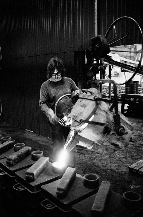 Filling moulds in the foundry at Lee Howl pump factory Tipton  (1978)