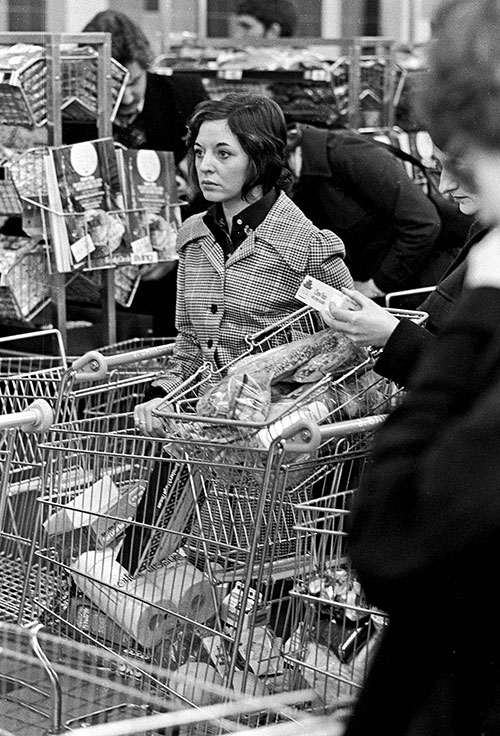 Woman in a supermarket queue, Birmingham  (1975)
