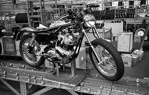 Unfinished motorcycles awaiting bodywork, Nortons