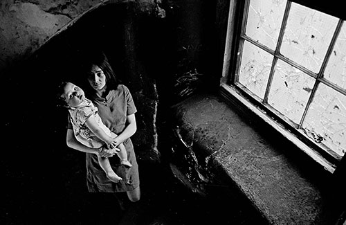 Mother and baby on the staircase to their Gorbals tenement flat, Glasgow  (1969)