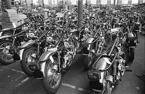 a phalanx of unfinished Norton motorcycles, Wolverhampton  (1976)