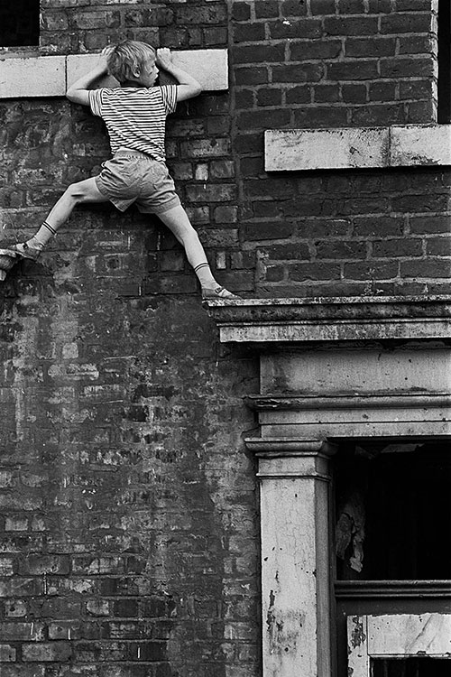 Boy playing on derelict property Newcastle  (1971)