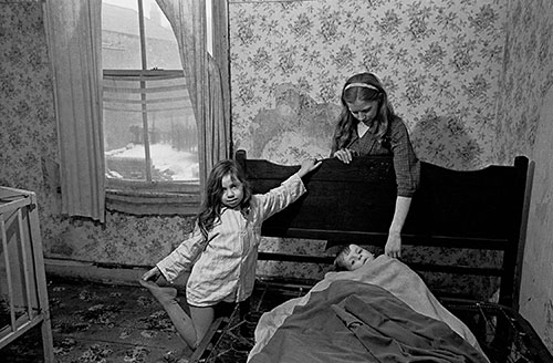 Mrs M puts her children to bed in their Balsall Heathslum, Birmingham  (1969)