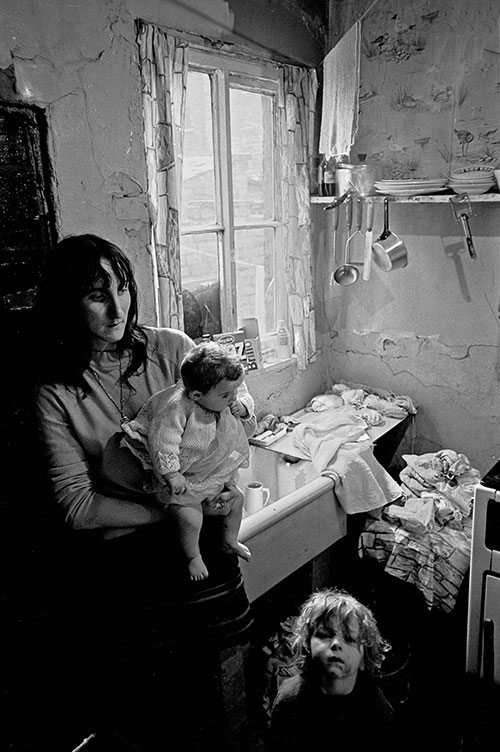 Mother and children in their Salford kitchen, (1971)