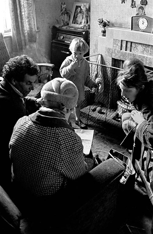 Social worker visits family in slum housing, Birmingham  (1967)