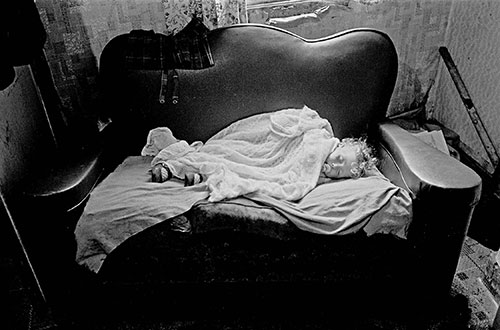 Baby asleep on sofa, Birmingham  (1971)