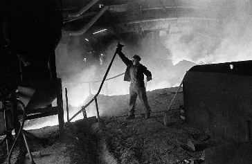 photograph of man working in foundry